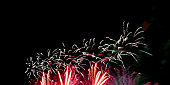 Red yellow fireworks, black night sky background