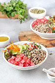 Healthy raw tuna bowl with quinoa and vegetales. Buddha bowl