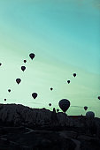 Wonderful hot air balloons flying over Cappadocia rocks in Turkey