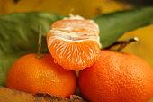 juicy tangerine. fresh tangerine on a yellow autumn leaf, closeup