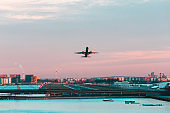 Airplane taking off from London city airport at sunset