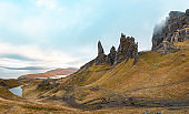 Beautiful travel landscape in the Isle of Skye at the Old Man of Storr, Scotland on a cloudy moody day - Autumn colours  - Nature and travel concepts