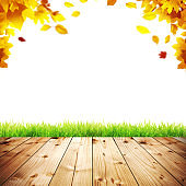 Colorful bright leaves falling on a wooden background