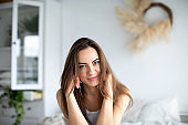 Young beautiful smiling woman in casual wear at home.