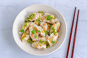 Shrimp Dumplings with Nam Jim Sauce in a White Bowl with Chopsticks Horizontal Directly Above Photo