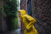 Man in raincoat exploring an old city of Bristol