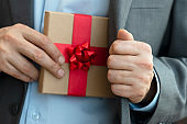 Businessman giving Gift Box