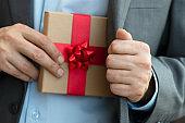 Businessman giving Gift Box