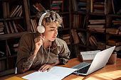 Young adult girl study at university library