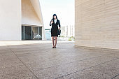 Business asian woman out of the office building using smartphone app - Young female worker going to work - Tech, entrepreneur and job concept - Focus on her face