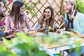 Young people eating brunch and drinking smoothies bowl with in eco bar restaurant - Healthy lifestyle, food trends concept - Focus on right girl face