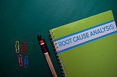 A Root Cause Analysis book isolated on Office Desk