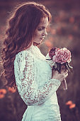 a beautiful portrait of a redheaded girl of the bride, a wedding ceremony in rustic or boho style.