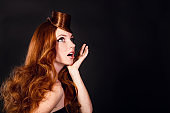 a beautiful young redheaded woman with stylish hairstyle