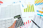 Financial printed paper charts, graphs and diagrams on the table. Top view