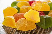 Close up of multi-colored marmalade of different shapes on table
