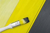 The board is painted gray yellow, brush.