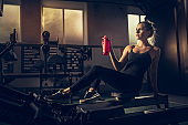 The female athlete training hard in the gym. Fitness and healthy life concept.