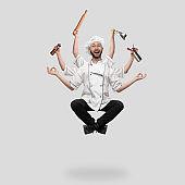 Cooker, chef, baker in uniform multitask like shiva isolated on gray studio background