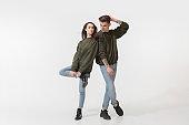 Trendy fashionable couple isolated on white studio background