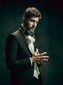 Young man as Dorian Gray on dark background. Retro style, comparison of eras concept.