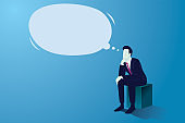 Businessman sitting and thinking with big empty dream speech bubble. Confused man thinking hard, looking for solution