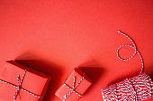Christmas presents wrapped red paper. New Year flat lay top view background. Template mockup greeting card. minimalism