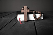wooden cross with Bible