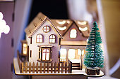 wooden house with christmas tree