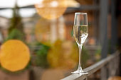 Glass of sparkling champagne, close up. Warm colored. Celebration event, holidays, drinks concept