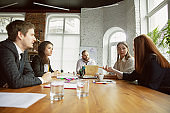 Group of young business professionals having a meeting, creative office