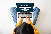 Top view of woman sitting on floor and using laptop job search. Online recruitment career business company concept