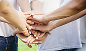 Power of male and female volunteer charity work. Stack of people hand. Team teamwork business join hand together concept