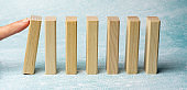 Hand arranging wood block stacking as step stair on wooden table. Business concept for growth success process. Copy space