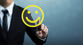 Customer service experience and business satisfaction survey. Businessman hand drawing smiley face
