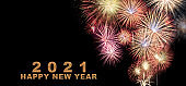 Abstract beautiful colorful fireworks display for celebration on black background with Happy New year text.