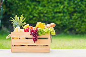 Full fresh vegetables and fruits in crate wood box