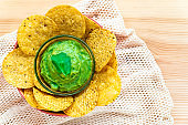 Mexican authentic homemade Guacamole with corn nachos chip traditional fresh healthy appetizer dip sauce for vegan