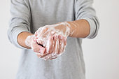 Man wash hands with soap for COVID-19 corona virus prevention concept