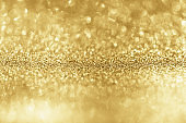 Abstract gold glitter sparkle with bokeh background
