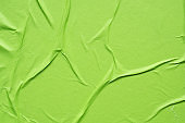 green crumpled and creased paper poster texture background