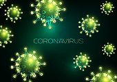 Futuristic coronavirus outbreak abstract background with glowing low polygonal virus cells