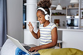 Young girl at home on a video call