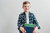 Young boy with books