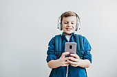 Portrait of a young boy with smart phone