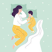 Beautiful mom and son are sleeping in bed. The concept of children sleeping together with parents. Flat vector cartoon illustration
