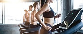 blur background group of Caucasian athletic people running workout on treadmill. side view of muscular men and woman do fitness exercise training at gym. healthy and lifestyle concept. copy space