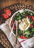 Italian salad with Buratta cheese, tomatoes, arugula and fresh basil