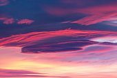 Dramatic sky background in purple, pink and orange hues. Abstract natural sunset skies skyscape, peaceful scenery in vivid colors, horizontal shot
