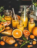 Fresh fruit vitamin immune boosting drink over kitchen counter, close-up